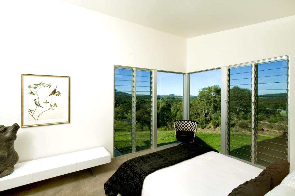 Enjoy scenic views with louvre windows installed next to large fixed panes of glass