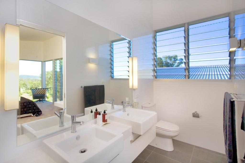 Louvres on second storey inside the bathroom provide ventilation and privacy from neighbours
