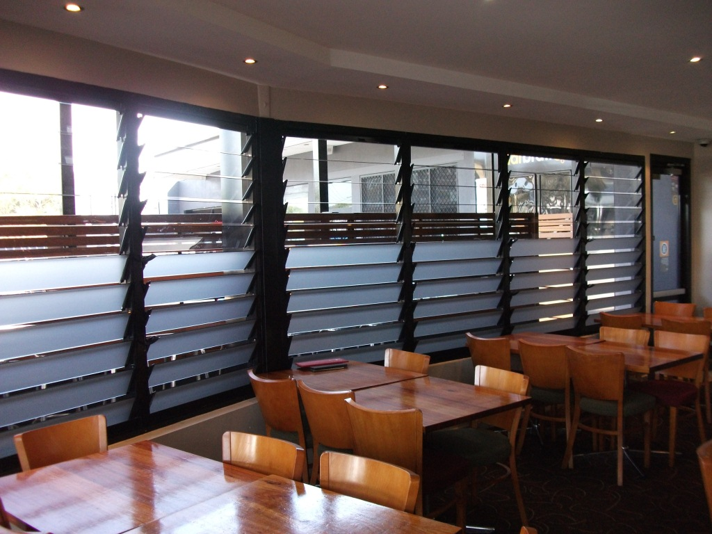 Mixing glass and frosted blades allow light and fresh air in for occupants to enjoy the restaurant