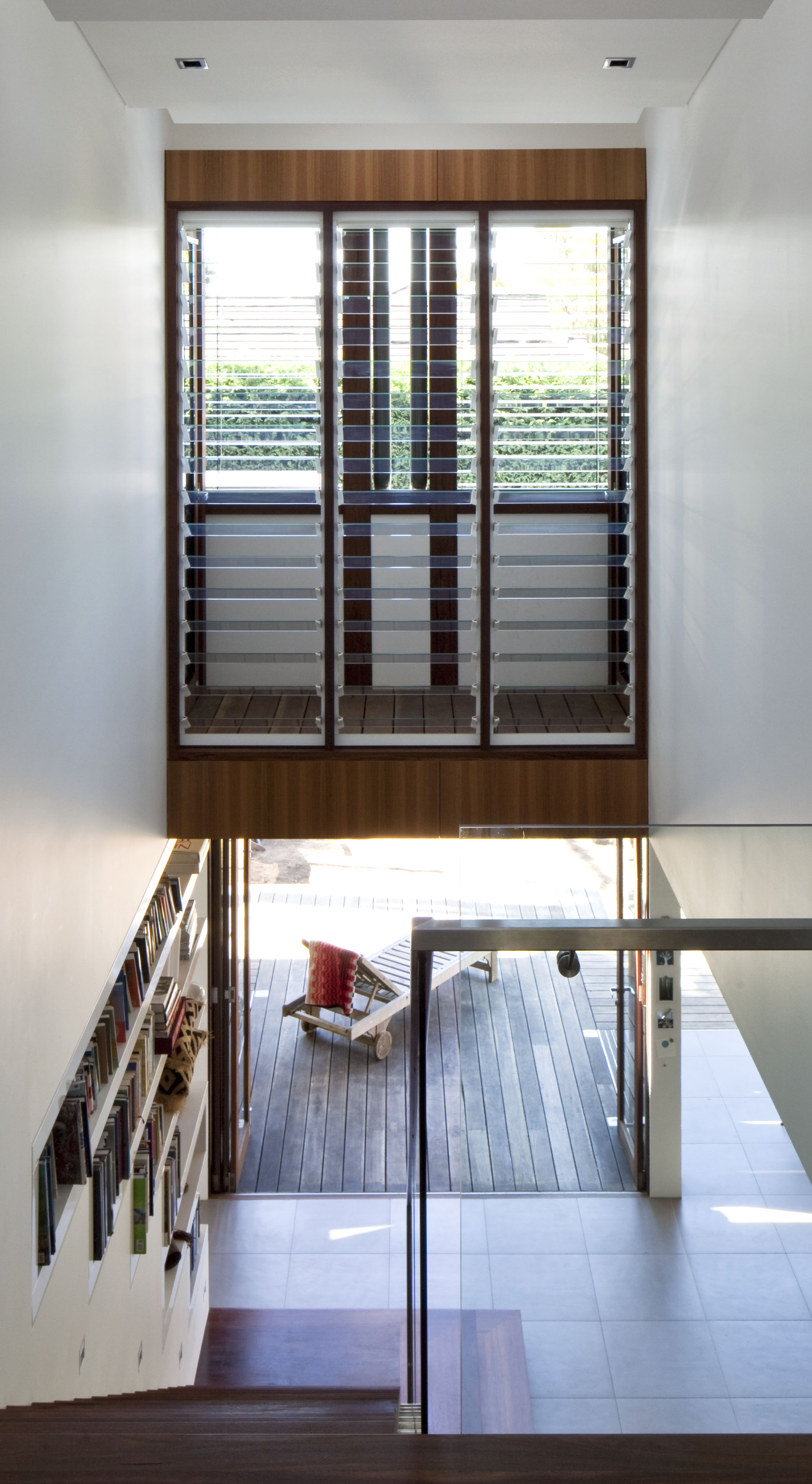 Staircase area showing floor to ceiling louvre windows