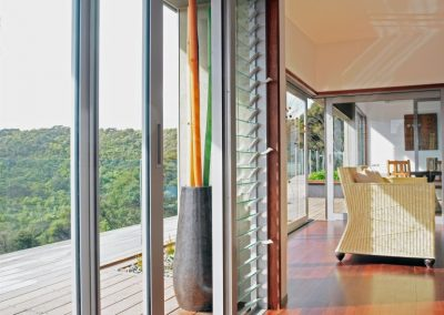 Breezway_louvres_next_to_sliding_door_in_living_area_provides_great_views