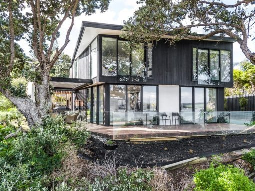 New Home Maximises Views Over Bay with Generous Forms of Glazing