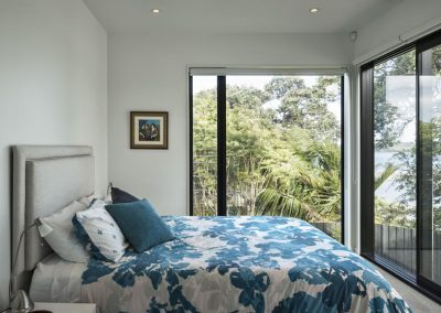 Bedroom maximises natural light and fresh air with Breezway louvres next to fixed lite glazing. Photo credit Simon Devitt