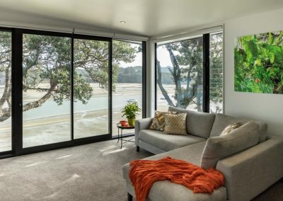 Enjoy uninterrupted views with floor to ceiling glazing and Breezway louvres. Photo credit Simon Devitt