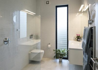 Make a statement with a bold Breezway louvre in the bathroom to allow natural ventilation. Photo credit Simon Devitt